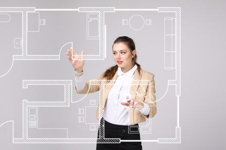 building planners: Female architect working with a virtual apartment plan. Virtual house design software. Stock Photo