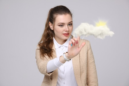 airiness: Young woman and sun shining out from behind the clouds, cloud computing or weather concept on grey background