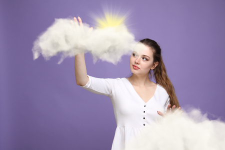 hopefulness: Young woman and sun shining out from behind the clouds, cloud computing or weather concept on violet background