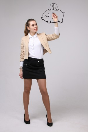 young businesswoman, woman drawing a piggy Bank Stock Photo