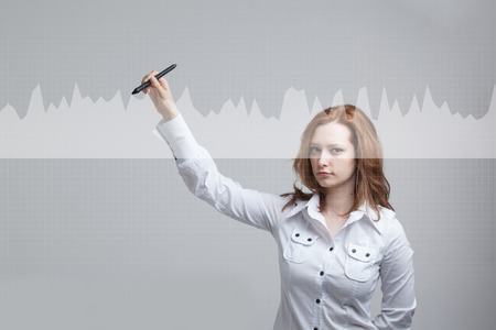 stylus: Young businesswoman with stylus working with graph chart. Future technologies for busines, stock market concept. Stock Photo
