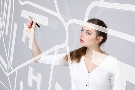 stylus: Future technology, navigation, location concept. Woman with stylus showing transparent screen with gps navigator map. Grey background.