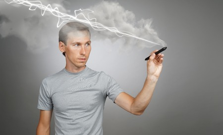 Young man making magic effect - flash lightning. The concept of copywriting or writing.
