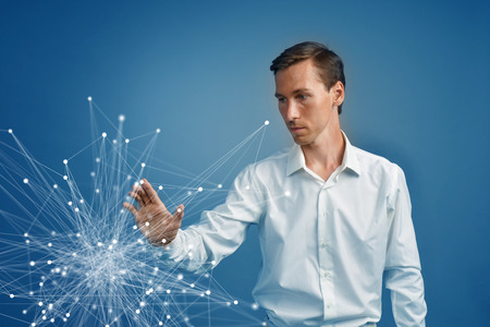 linked: Young businessman in white shirt working with linked dots on blue background. Wireless connection or global network concept.