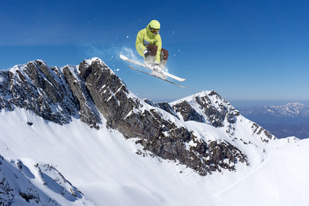 freeride: Flying skier on high mountains. Extreme winter freeride sport.