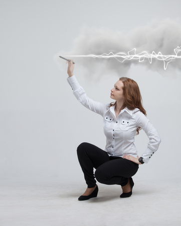amperage: Young woman making magic effect - flash lightning. The concept of electricity, high energy. Stock Photo