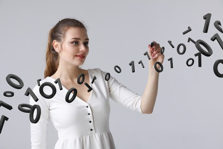 stylus: Young woman working with binary code, concept of digital technology.