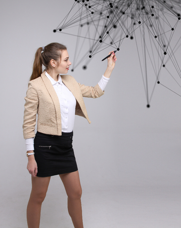 Worldwide network or wireless internet connection futuristic concept. Young woman working with linked dots on grey background. Stock Photo