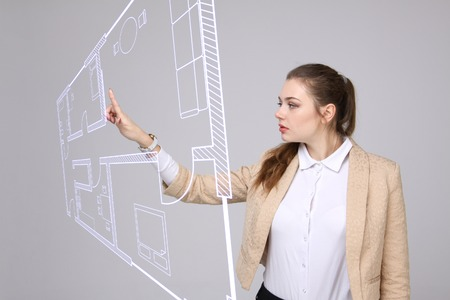 Female architect working with a virtual apartment plan Stock Photo