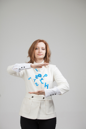 to encode: Woman working with a set of letters, writing concept.
