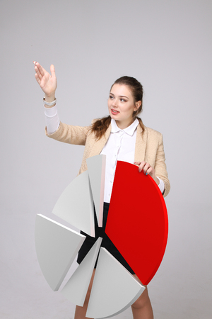 analytic: Woman shows a pie chart, circle diagram. Business analytics concept.