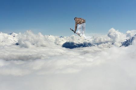 Ski rider jumping on mountains. Extreme freeride sport.