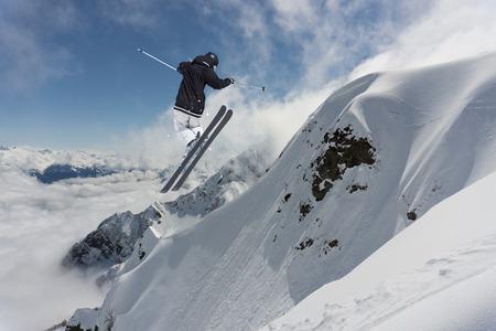 freeride: Ski rider jumping on mountains. Extreme freeride sport.