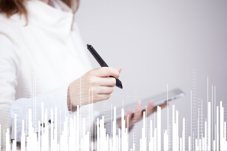 Finance data concept. Woman working with Analytics. Chart graph information on digital screen. Stock Photo