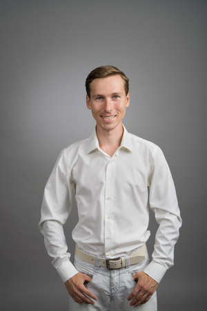 successfulness: Business man in white shirt, portrait on grey background.