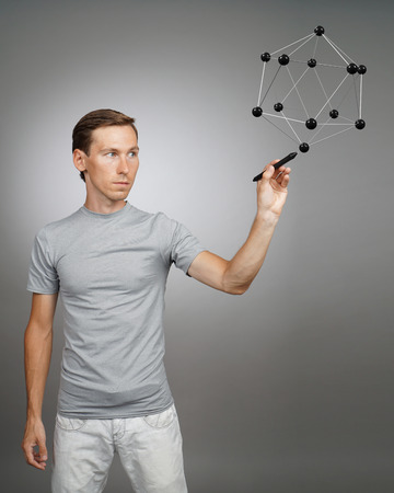 particulate: Young man works with a model of molecule.