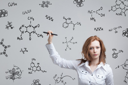 stylus pen: Woman chemist working with chemical formulas on grey background. Stock Photo