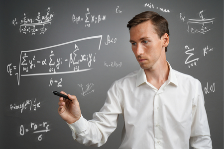 stylus pen: Man scientist or student working with various high school maths and science formulas. Stock Photo