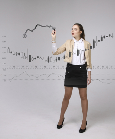 Finance data concept. Woman working with Analytics. Chart graph information with Japanese candles on digital screen. Stock Photo