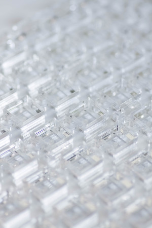 Abstract high-tech geometrical background. A sheet of transparent plastic or glass with the cut out holes. Laser cutting of plexiglass. Reklamní fotografie