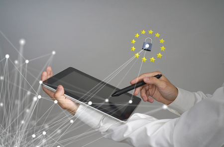 GDPR or DSGVO concept. General Data Protection Regulation, the protection of personal data. Young man with tablet works with a virtual interface.
