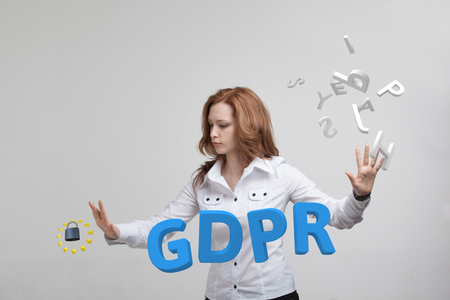 GDPR, concept image. General Data Protection Regulation, the protection of personal data. Young woman working with information. Stock Photo
