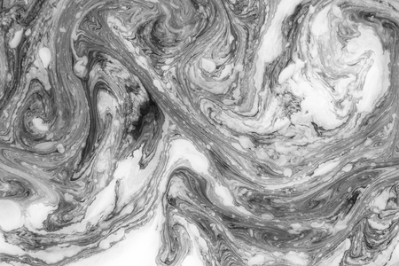 Abstract monochrome marble background. Stains of paint on the water. Imagens