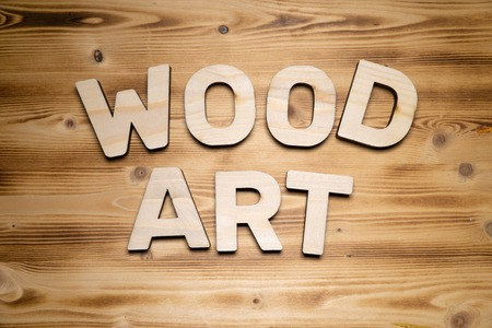WOOD ART words made of wooden letters on wooden board.