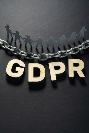 GDPR letters in front of human paper figures and metal chain. General data protection concept. 스톡 콘텐츠 - 120882451