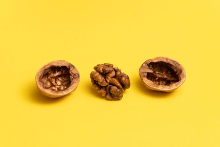 Delicious walnut on yellow background.
