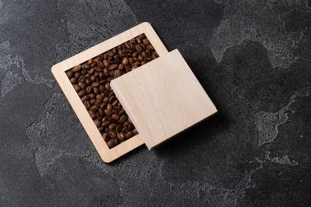 Coffee beans in wooden box on a dark background. Reklamní fotografie