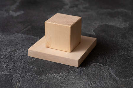 Wooden blocks on concrete surface.