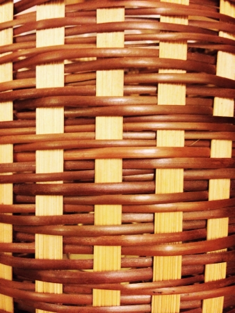 weave: A wicker basket close-up photo texture with shallow depth of field Stock Photo