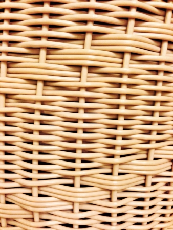 woven: A wicker basket close-up photo texture with shallow depth of field Stock Photo