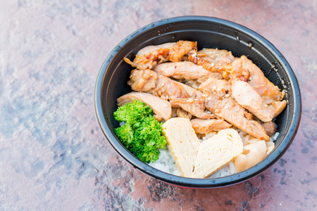 serves: Japanese food rice serves with chicken in Teriyaki sauce