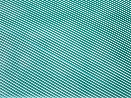 slant: green rubber hot water bag,slant line,background Stock Photo