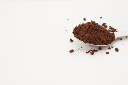 grind: drip grind in spoon put on white background Stock Photo