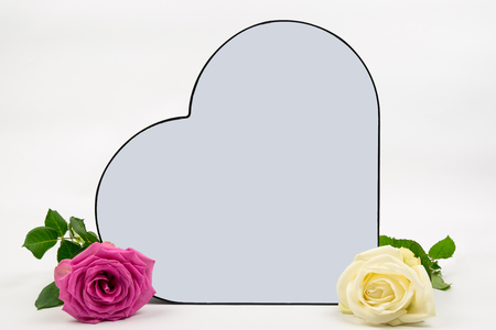 a rose with a pink rose on the side. the heart has space to put on your own text. Can be used as a background