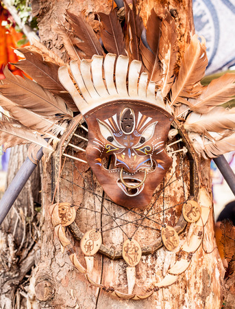 Aboriginal battle mask on the tree  photo