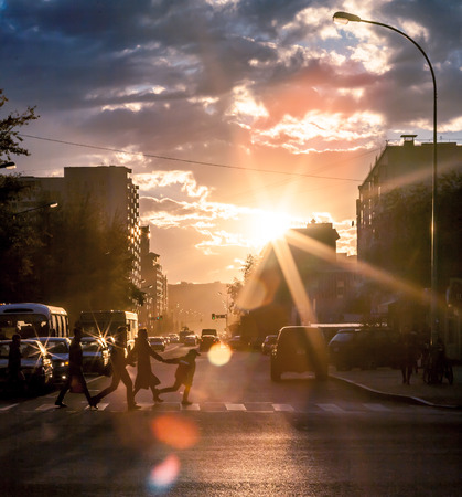 Urban life in vain hour before sunset, the city of Astana Kazakhstan.To me these shots especially the road. Picture which can be called art.