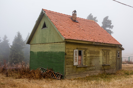 abandoned house: Forgotten and abandoned house in the fog Stock Photo