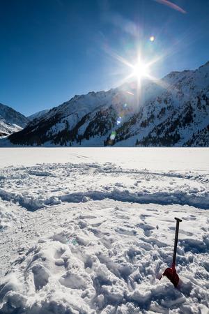 Skating on frozen mountain lake, sun and fun Stock Photo - 26330651
