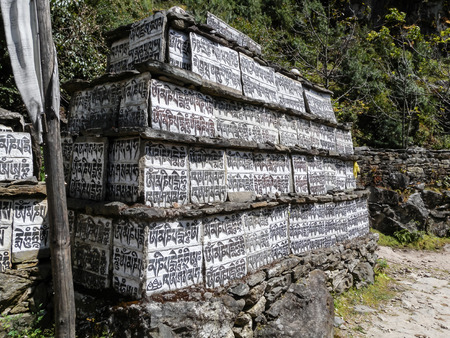 Buddhist stone library is located almost everywhere along the trails Nepalese photo