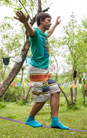 slack: People on the nature walk in the sling and rest - Slackline