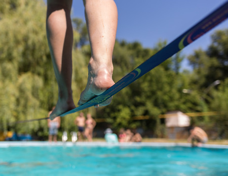 People walk on the sling over the water Standard-Bild