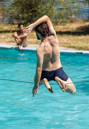 slack: People walk on the sling over the water Stock Photo