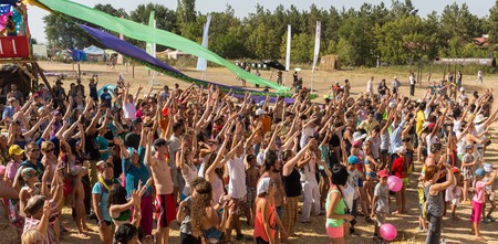 A large number of people in the colorful outdoor festival