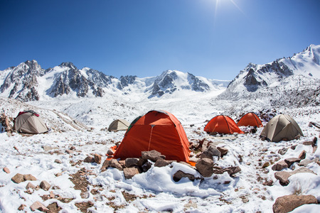 People in a tent in the mountains photo