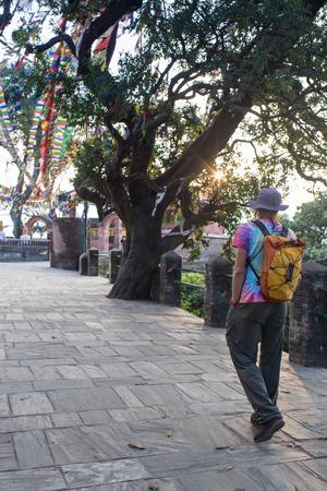 buddhist stupa: A man near the Buddhist stupa - Tourist