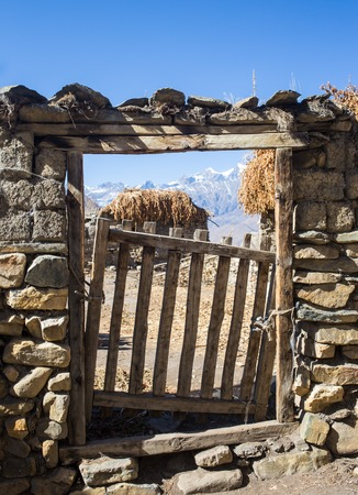 wicket: Metal wicket in a brick fence in the Nepal